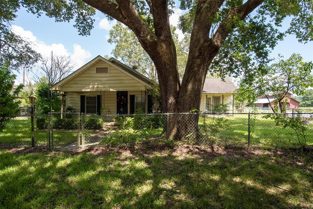 Located on FM 2501 just a half-mile from Apple Springs is this desirable 10+/- acre farmstead offering pretty pasture, a small pond, several useful outbuildings, & older 3BR/2BA/1GA farm home set underneath huge live oak trees! The home, originally built in the 1940's but has been expanded since, has approximately 1,676 sf and offers central/heat air, ceiling fans, two living areas, a sun porch, and a huge 14'x20' master suite w/attached bath. A large covered front porch and a private covered wood side deck offer great views of the fenced yard and beautiful shady oaks. Property also has a 2-car carport and one-car detached garage w/several attached storage areas. The land is fenced and primarily open native pasture with a one-acre hay field and is currently used for grazing cattle. One large hay barn, a smaller equipment barn/shed, & workshop are also on the property.  An ideal country setting in a quaint east Texas community located less than 90-minutes from north Houston & Kingwood!