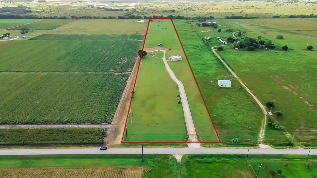 This over 13-acre piece of land near the heart of Needville is all prepped and ready for your dream home! Featuring a 2,400 sq ft metal barn (40x60) complete with half bath, two roll-up doors, ample electrical outlets, and plenty of room for any hobby you could imagine. The land already has electricity, oversized septic and well to support more than one home, gated access, and driveway. This land once utilized as a grass farm is the perfect blank slate to build the perfect home you've been imagining for your family. Raise chickens, a few cows or start a bee farm! These wide-open skies are the limit!