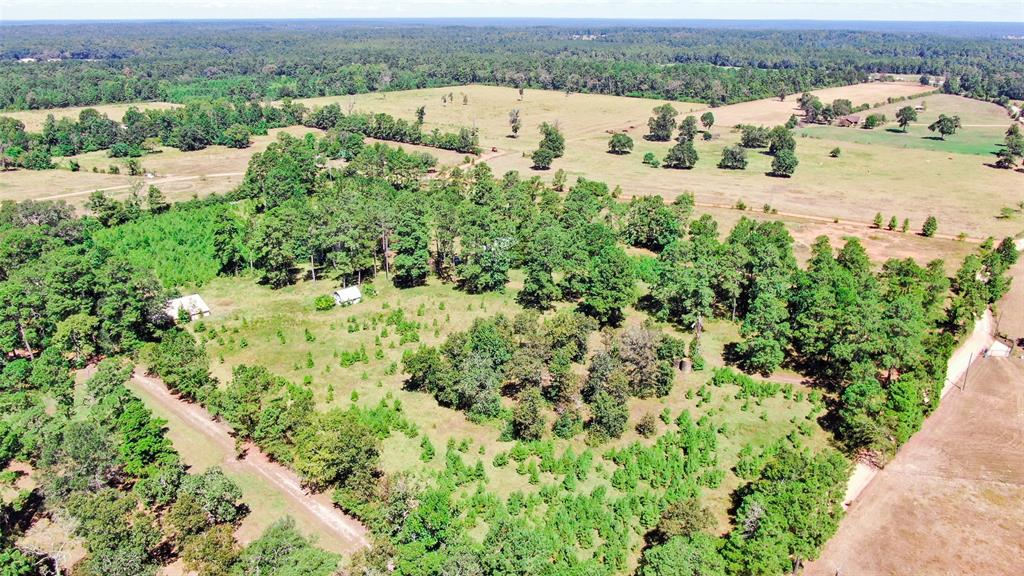 Over 13 unrestricted  acres on this highly sought after area in Willis Tx. Come build your dream home or remodel the home that is on the property. Gated entrance, pond, home, cabin and barn waiting to be brought back to life on this beautiful rolling property. There is three wells on the property and one septic. Live the life of a rancher but so close to restaurants, hospitals, shopping and more. Septic and well on the property. The pond is stocked. Property is fenced and cross fenced. Its hard to find this type of land that just needs a an uplift and will be worth a whole lot more than what  you pay for it. Willis ISD and San Jacinto Taxes. This property is timber/Ag exempt.