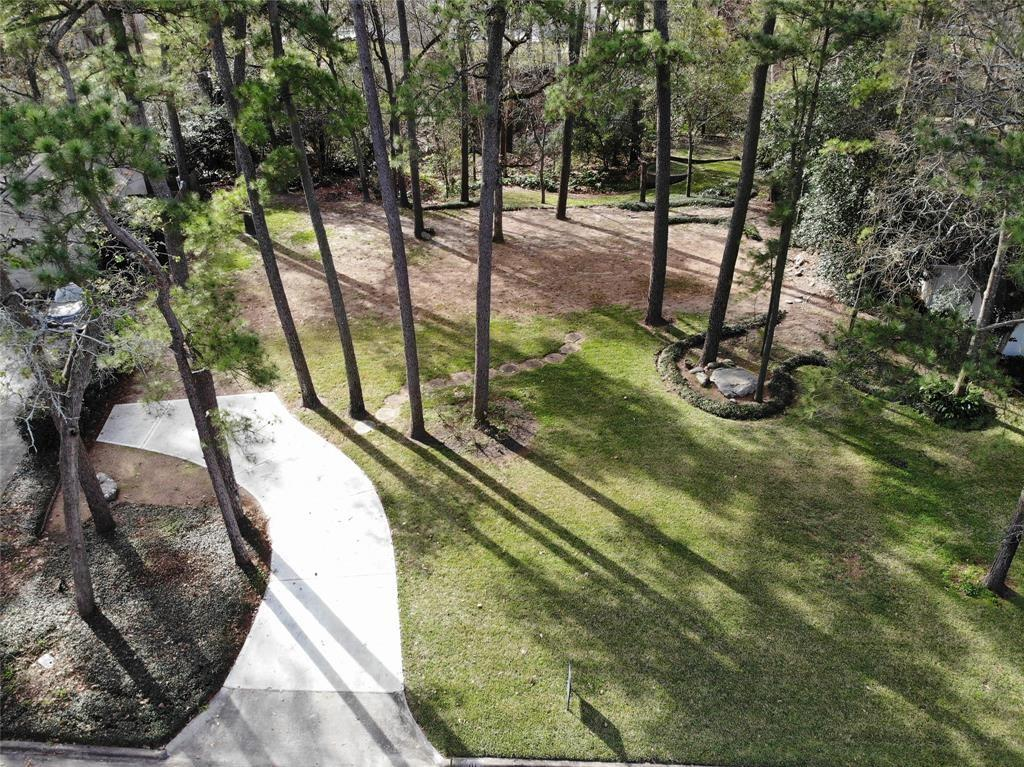 One of the last oversized lots (1/2 - 1 acre) on Electra. Imagine living in a bird sanctuary. That's what life is like in the bucolic setting at 311 Electra Drive in Memorial Bend. This beautifully wooded homesite is cleared and ready for your new home. Sitting high above Rummel Creek and zoned to Memorial Middle & Memorial High School. Just minutes from City Centre, and a short jaunt to Downtown & the Galleria. PLEASE SEE ATTACHMENTS, CURRENT FLOOR PLAN AND BLUE PRINT AVAILABLE FOR THIS LOT.