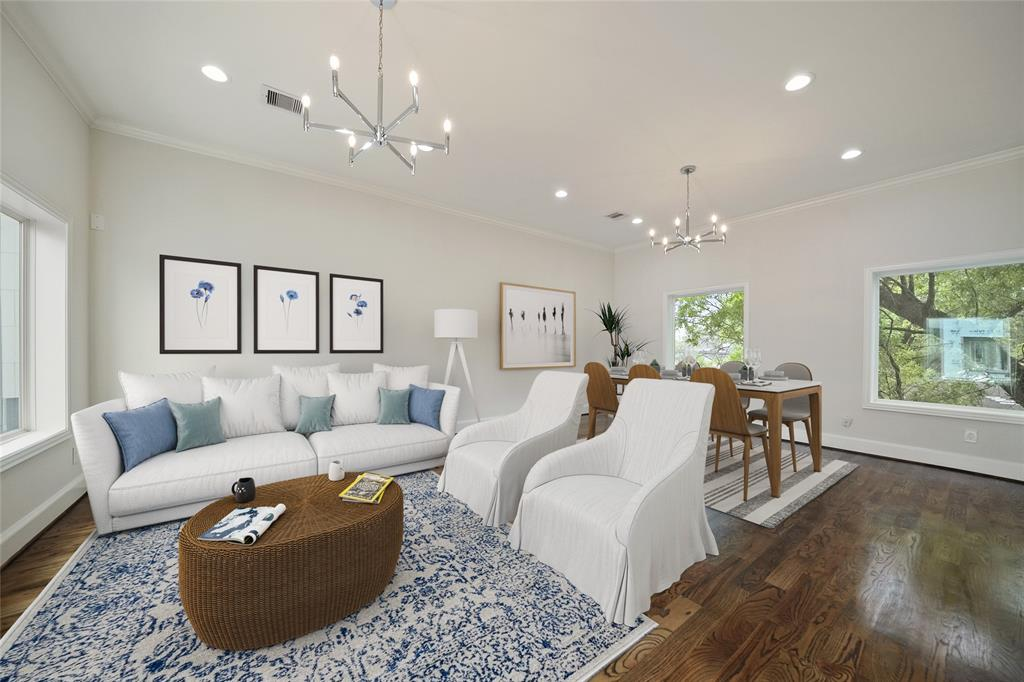 On the second floor, a large living & dining space is open from the kitchen. It also includes high ceilings, beautiful hardwood floors, and recessed lighting throughout. *furniture is virtually staged*