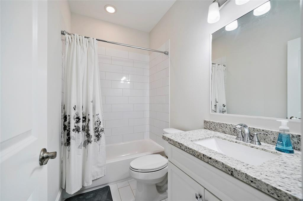 The bathroom en-suite is located just off the 3rd floor bedroom and includes subway tile surround and granite counter-tops.