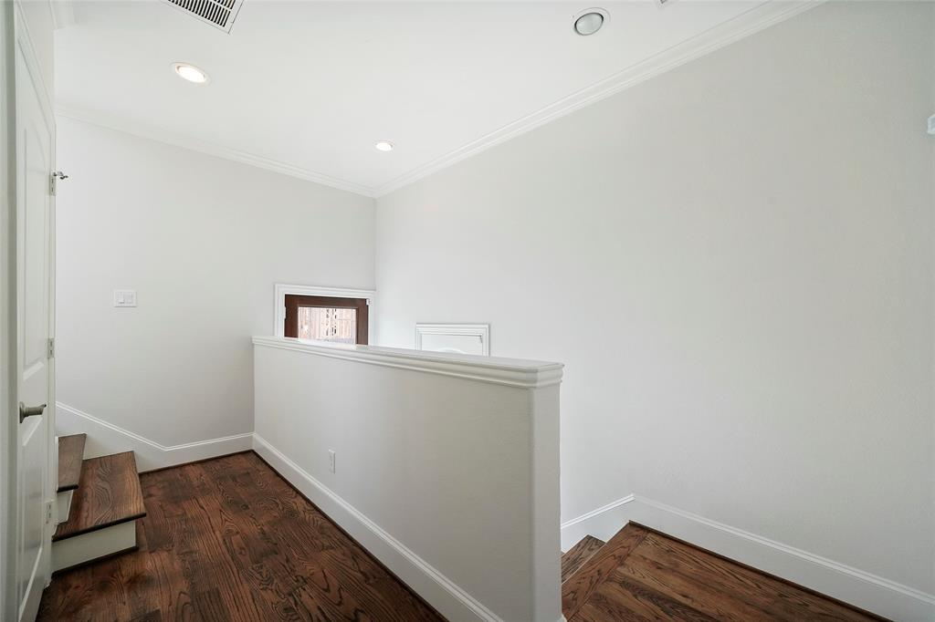 A view of the entry way showing a storage closet and the beautiful wood floors.