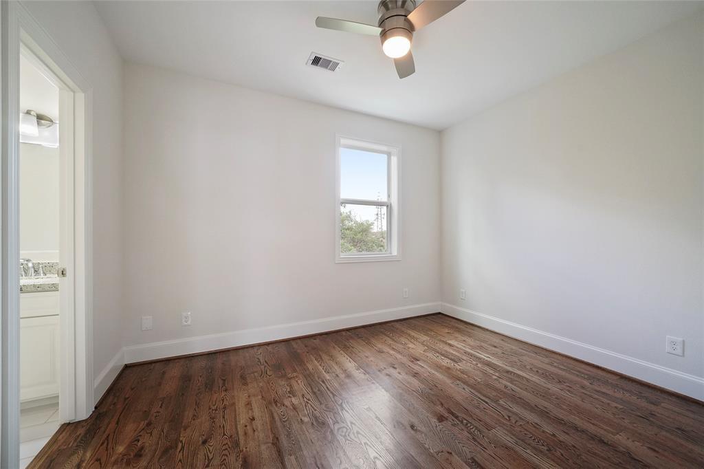 This 1st floor bedroom has beautiful wood floors and it's own en-suite bathroom.