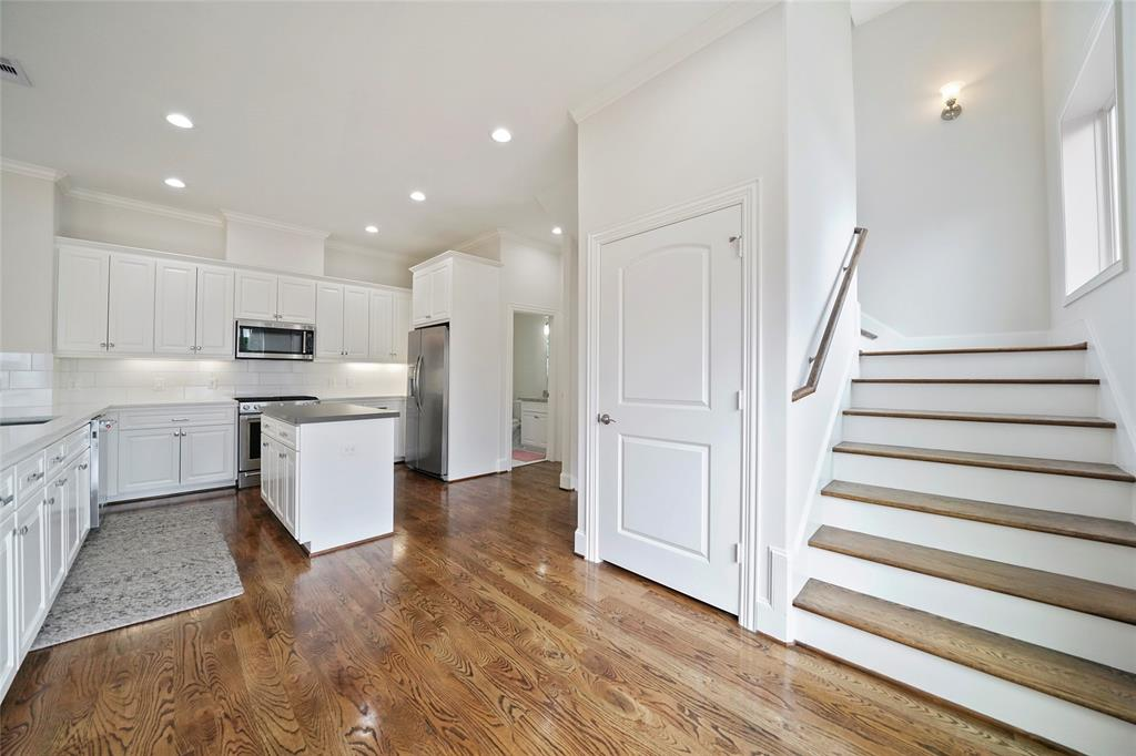 There is a large pantry and plenty of cabinetry storage.
