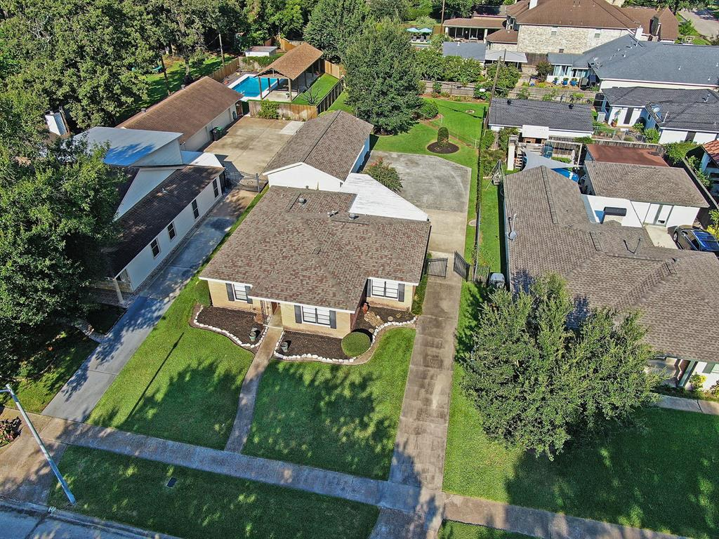 This beautiful home is nestled on a prime, oversized (almost 10,000 sq feet!) lot in the heart of Oak Forest. Zoned to Oak Forest Elementary, this beautiful home is livable with unique and original features and can be remodeled into your dream home. There are many $1,000,000+ new homes on this street, and many amazing neighbors. The main home features two bedrooms, two bathrooms, and a MASSIVE laundry room (ahead of its time!). Oversized 3 car garage is tucked away behind the home with a motor court and has one oversized bay as a workshop, with the remaining two spaces for parking/storage. Massive yard with endless possibilities! Meticulously maintained, this is the one you have been waiting for.