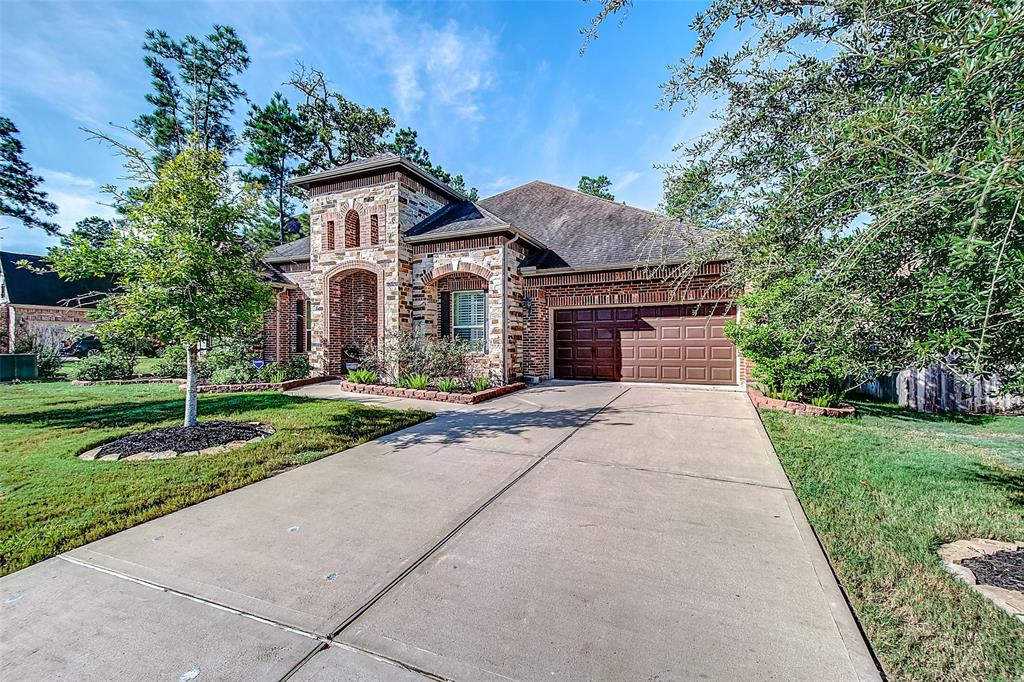 Executive home by Taylor Morrison on a cul-de-sac street of Audubon Grove of Springwood Village. The 3/4 bedrooms, 3 car garage, single story home features an open layout w/ many high-end finishes; stone elevation & bricks all sides, plantation shutters, motorized sunshades, stone surround fireplace, granite countertops & much more.  Step into the home and you will discover soaring ceiling and vast living spaces, a formal dining room, study w/ French door, butler pantry with wine cooler, a gourmet chef/entertainers island kitchen with stainless steel appliances opens up to the living/family room, large master bedroom with sitting area, den or 4th bedroom with access door to the patio.   Step out to the spacious covered back patio w/ built-in outdoor grill to enjoy your outdoor activity or take a walk, run or biking in the community's trail. Mins to I-45, 99 Grand Pkwy, Exxon, HP, Southwestern, retail & dining.  Never flooded!