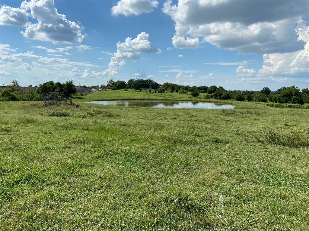 Approximately 30.84 acres comprised of two tracts. Corner of Hwy 36S and all Jersey road near Brenham. Hilly, two ponds, water well, and septic in place. Lots of road frontage and potential for dividing. List price $50,000 acre all or part. Seller to keep minerals