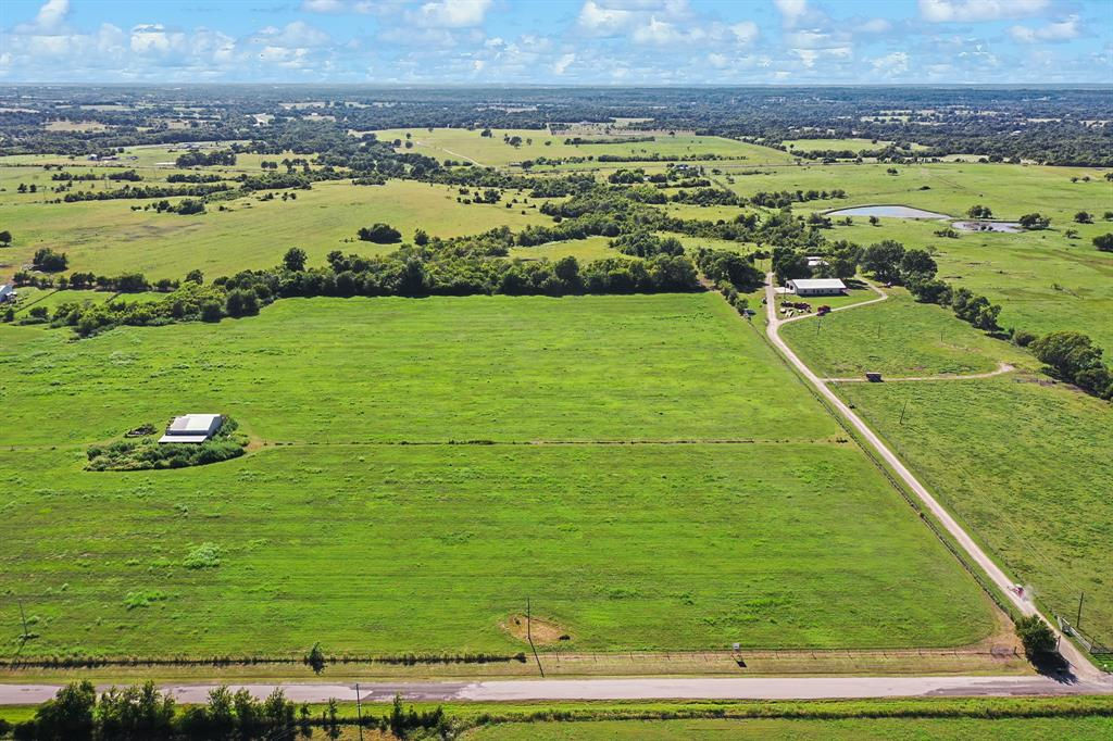 Here is the 15 acres of raw land you have been searching for close to Hwy 105 and situated between Montgomery and Navasota! Easy access to Hwy 105, as the property is located only 1.65 miles from Hwy 105 down a black topped county road. Additionally, this tract is located only +/-3 air miles from the new Aggie and Hwy 105 connection and approximately 5.4 miles by road. Perfect blend of convenience and clean country living; with rolling topography, long distance views, good CR frontage and clusters of trees/wooded areas at the back of the property that offer the privacy one seeks when building a dream home. Electricity access at both the front and back of this tract, allowing multiple options for bringing power to your build-site; also a public water line at the county road. Currently under ag exemption that can be easily maintained moving forward. Light restrictions in place to protect property values moving forward. Call today to schedule your appointment to view in person!
