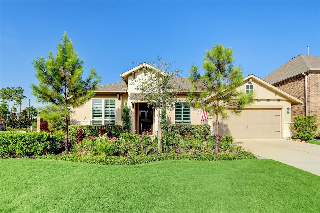 Large Perry Home - Mahogany front door. Brick and stone elevation. Entry and extended entry with 13-foot ceiling. Library with French doors and formal dining room set at entry, both rooms with hardwood flooring. Huge kitchen with wrap-around countertops and plenty of counter-space & storage.  Including a middle island with a walk-in pantry and butler's pantry. Family room with ceramic tile floor features a 14-foot ceiling and a wall of windows. Private master suite with another wall of windows. Double door entry to master bath with dual vanities, two walk-in closets, garden tub, separate glass enclosed shower. Spacious game room (or media room) just off the family room. Large utility room with plenty of storage. Extended covered backyard patio with ceiling fan and gas connection for your dream outdoor kitchen. Tandem three-car garage with plenty of space and mud room as soon as you enter the home from the garage.