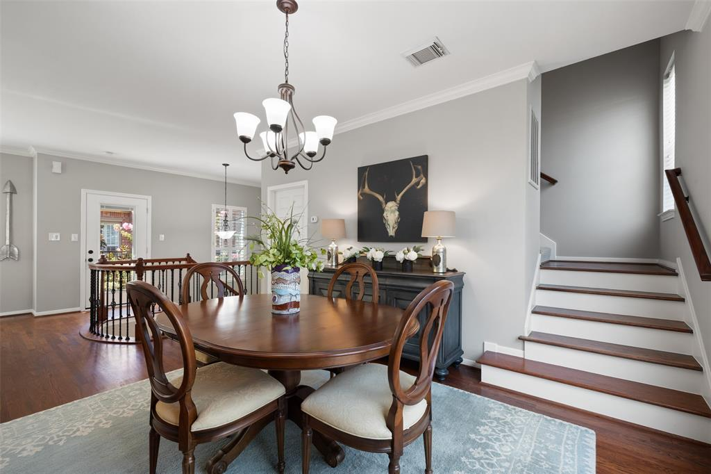 Adjacent to the living room and kitchen is the dining room, as well as the utility room next to the stairwell
