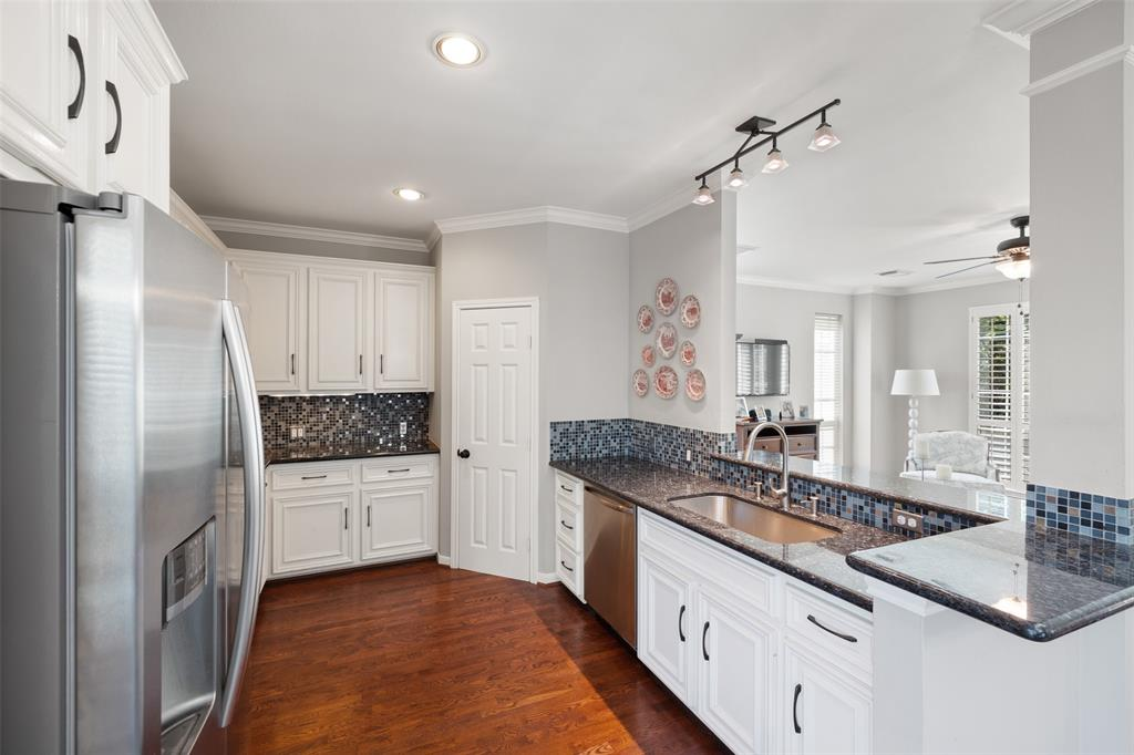 The kitchen features a large farm sink, Bosch and Samsung appliances