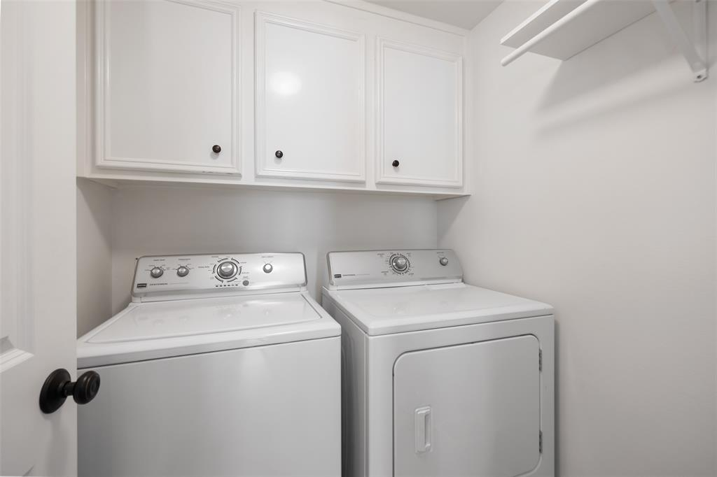 The ulity room has space for full-size appliances and offers more storage