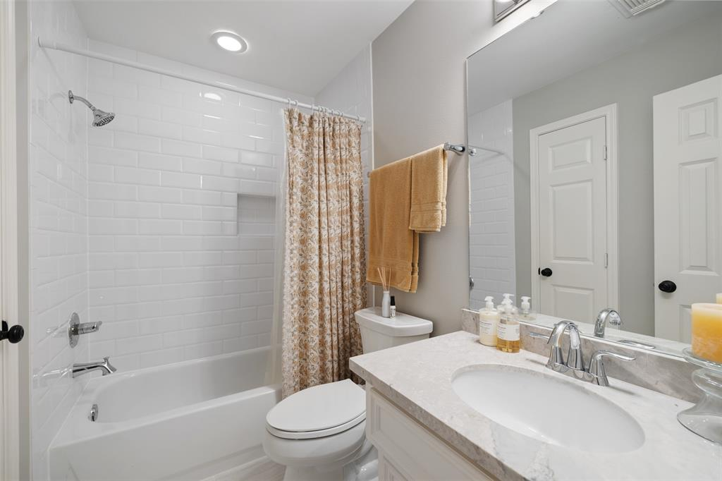 This 3rd floor bathroom was updated in 2017 including new shower tiles, granite countertops, fixtures, lights, and a new toilet