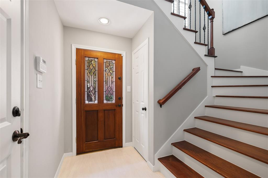 As you enter you're greeted by an open stairwell and bright, and clean tile