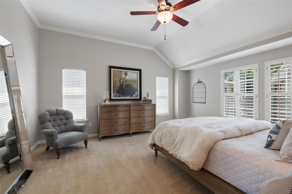 A bit further down the 3rd floor hall you enter the Primary Bedroom with lots of natural light, and high ceilings creating an urban retreat