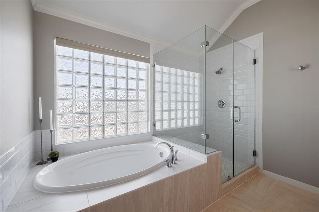 The shower was updated to be frameless and a giant soaker tub was installed in 2017