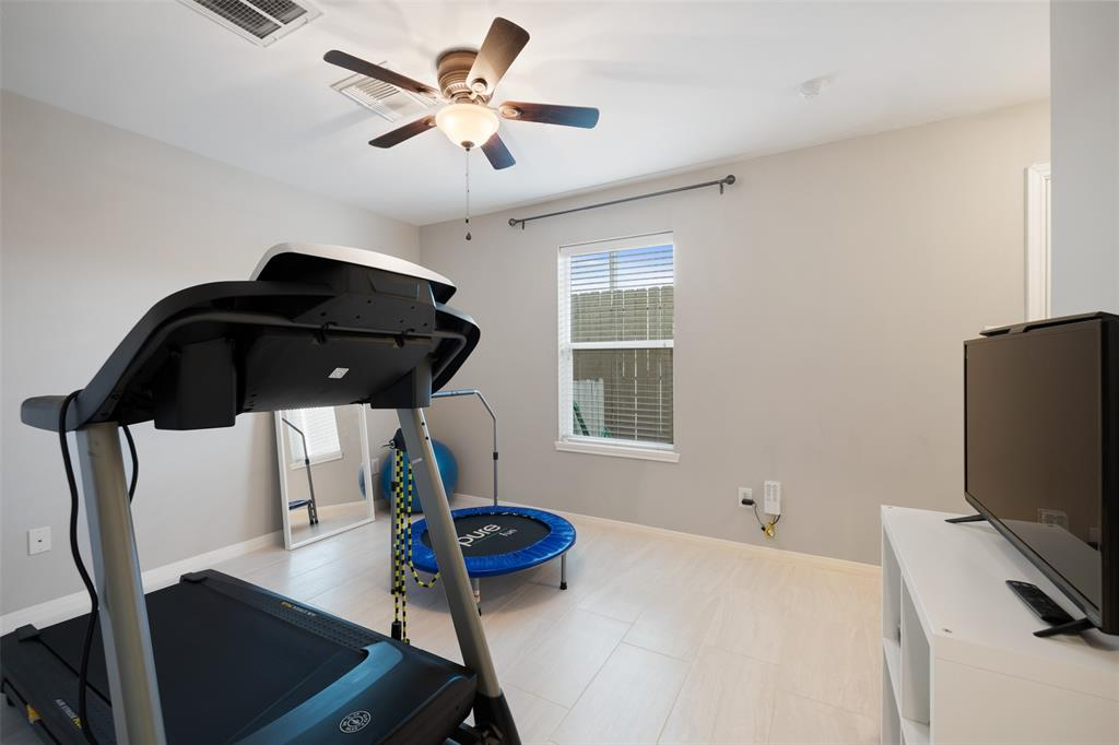 A generously sized 1st floor room that can serve as a bedroom, office or workout room