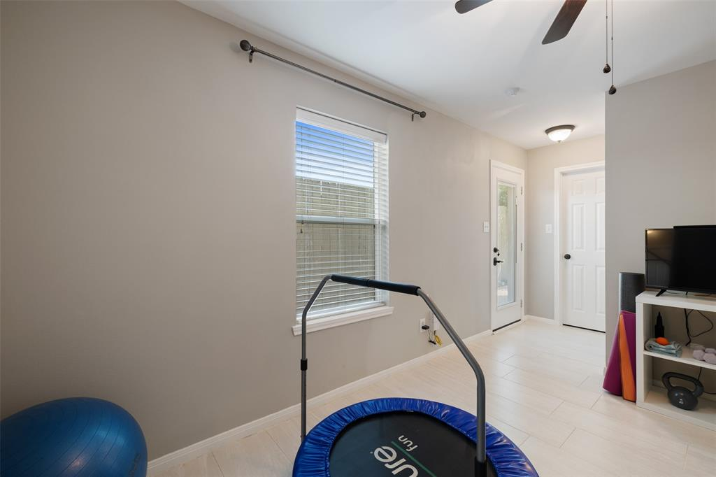 The 1st floor room leads to the back patio door and features a large walk-in closet