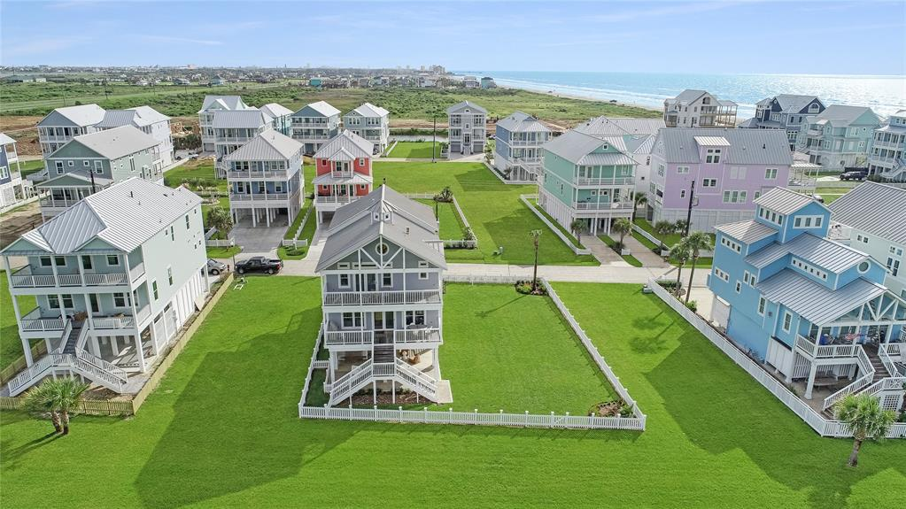 Truly spectacular beach house in Beachside Village. The chic coastal 5 bedroom 5 bath home sits just steps from the beach in a prestigious beachside subdivision. The home backs up to greenspace allowing for vast views & room to play. Tongue & groove pine floors are found through the first floor & most of the second. Open floor plan includes dining, living & kitchen with beach views. Stainless appliances, granite counters, bead board backsplash and inlaid wood cabinets.  2 bedrooms downstairs with 3 more upstairs 4 with en-suite bathrooms.  The primary bedroom features soaring vaulted ceilings, a private deck, En-Suite bath, and large walk-in closet. There is plenty of outdoor gathering areas perfect for hosting all of your friends and family.  The home conveys furnished. Never been used as a vacation rental.  Vacant lot to South can be purchased for a separate price.