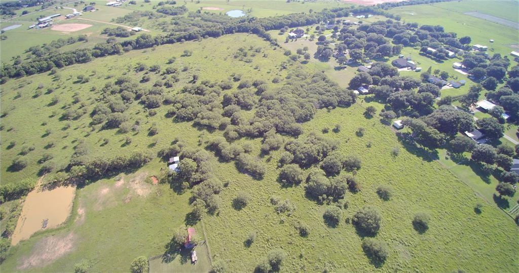 Approx 30 acres being divided out of a 49.74 acre tract  (Price adjusted per acre -/+).  535 feet of frontage on FM 1094.    Located approximately 2 miles northwest direction from downtown Sealy on FM 1094. Close to well established small country subdivisions and just minutes from the new Sealy Elementary school. This property would be ideal for a new home development, for business offices, warehouses, or retail stores.   Currently AG exempt,  LOW TAXES.  Mildly restricted, Minerals negotiable.  Austin County water tap access available.