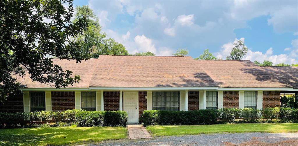 Over 2 acres on a wooded lot with a circle drive and gated access.   This home hits the spot when it comes to entertaining!  Pool area with pave stone patio and a pergola that is easily accessed from the living rooms impact resistant double pane sliding glass door.  All windows on north side are also double pane windows designed for security and hurricane strength winds.  2 vehicle, attached carport constructed out of heavy steel I-beams and attic space (with access ladder) for storage. Large barn that features an 1 bed/1 bath, kitchen & living accessory dwelling unit with a sauna in the bathroom.  12'x12' electric roll-up door, walk-in cedar closet and the barn is fully insulated with an end to end ridge vent and on a slab.   Also included is a double RV shed electricity.  All extras were built to last with heavy duty steel. Just around the corner from shopping and entertainment as well as easy access to the Beltway and Interstate.