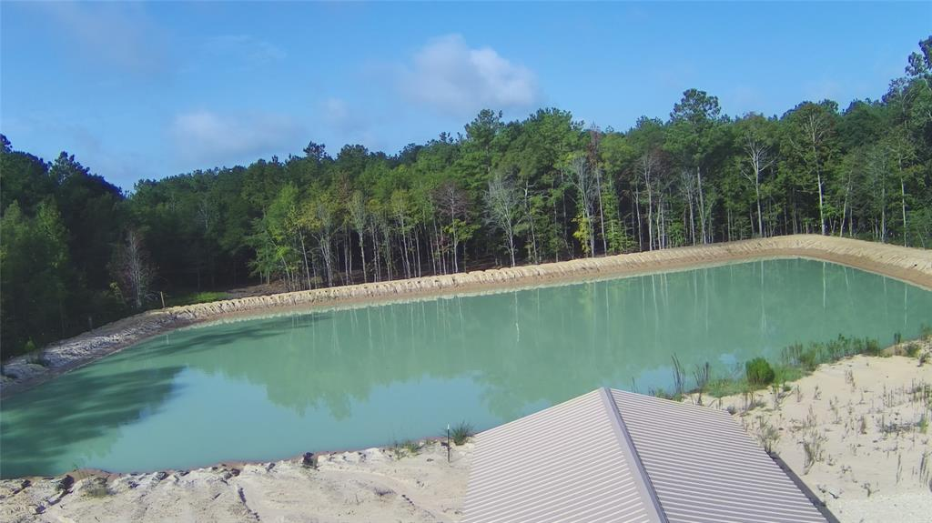 5 unrestricted acres in the Big Sandy School District.  This land has been completely cleared and leveled with a 1 acre pond.  The pond has been stocked with bluegill, sunfish, minnows and largemouth bass.  The tract also has a 30 x 20 foot shop building with double roll up doors and is partially fenced. This tract is great for all of your farming needs.