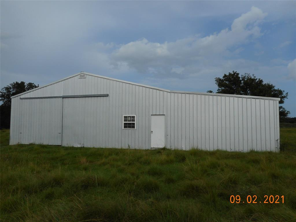 """BEAUTIFUL TRACT IN CLOSE PROXIMITY TO HOUSTON!  A rare find, this property is graced with majestic oaks and pecan trees and a small creek running through the middle of the tract.  There is 686' of road frontage on a farm-to-market road.  A 40 - 60 metallic barn on slab was built in 2006 and has 2 pedestrian doors and one 12' overhead door.  There is a 20 x 60 cow shed attached on the south side of the barn.  The 2"""" water well was installed 2008.  Pastures are improved with part Jiggs and part Bahia grasses."""