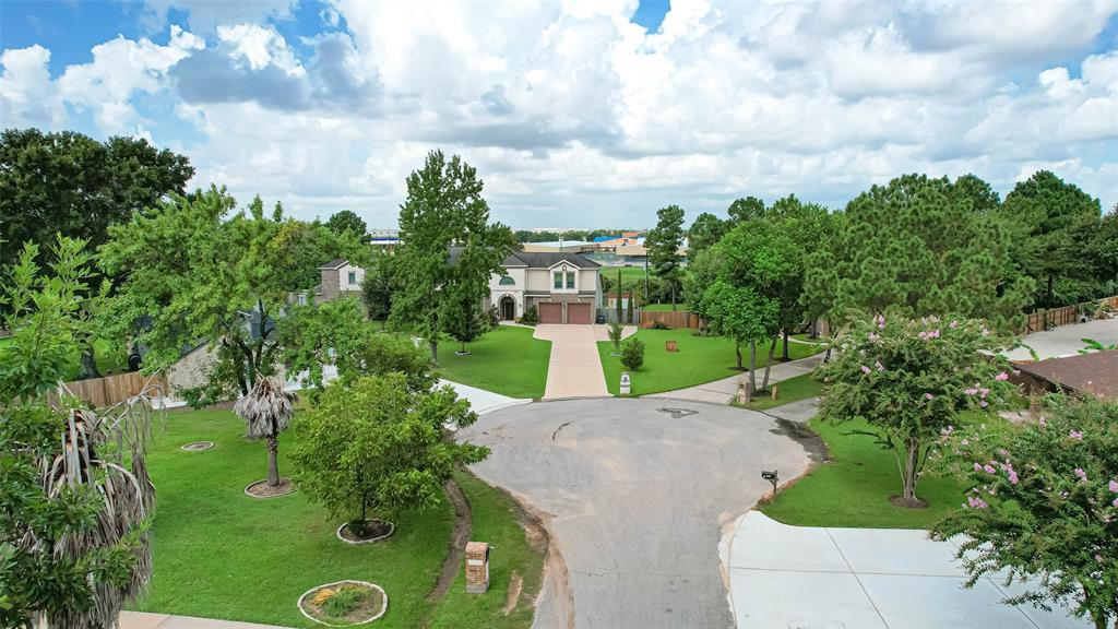 """Scenic views await you at this beautiful custom home tucked away in the heart of Cypress! This rare gem offers plenty of space to grow with opulence and luxury throughout! Highlights include a gourmet chefs kitchen with two sinks and pot-filler, 1st floor media room with 120"""" screen and 4K projector, expansive 20' ceilings in the living room with large windows for natural lighting, an air conditioned covered patio, two en-suite bedrooms, a custom built office with built-in shelving, and a luxurious owners suite with a coffee bar and two private balconies! Enjoy an abundance of yard space on over half an acre of land with plenty of room for a future swimming pool and outdoor kitchen. Country living with city convenience awaits you with quick access to HWY 290, Boardwalk at Towne Center, retail shopping, and gourmet restaurants! Don't miss out on this wonderful opportunity to live in a central location with LOW taxes!"""