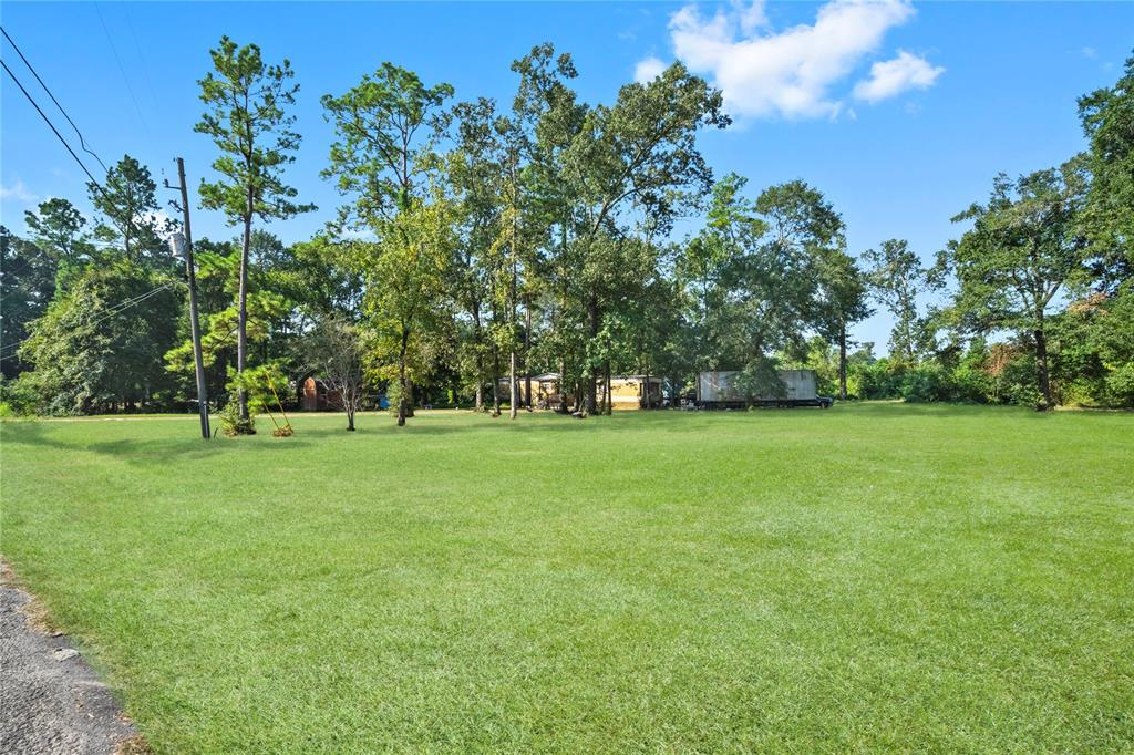 Situated on a 7.36-acre tract of lush wooded, Exceptionally Beautiful Property, Come Build your DREAM HOME on 7.36 Acres. This property comes with a mobile home (in Good Condition) and a storage shed. Closer to I 45 But still Country Living just minutes from The Woodlands, yet out in the County. Have the Best of both worlds, Country Living yet close enough to town. Rare opportunity to own a big plot of land THIS PROPERTY IS WAITING FOR YOU TO CALL IT YOURS! Schedule a showing today!