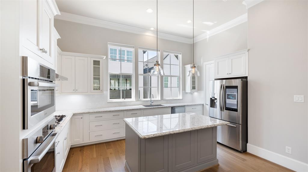 From the automated window shades above the sink and the smart refrigerator, you're going to love all of the tech upgrades that make this home and this kitchen so special.