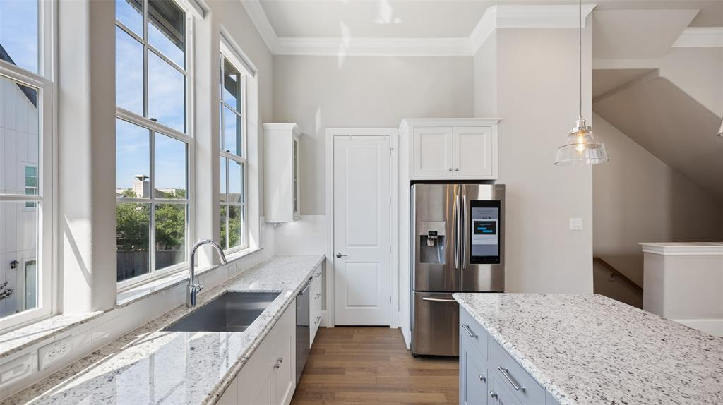 The kitchen also offers a deep under counter sink and a large walk-in pantry. The pantry includes an automatic light.