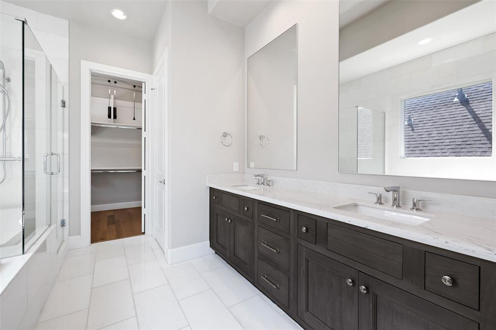 The primary bathroom includes a huge double vanity with tons of storage.