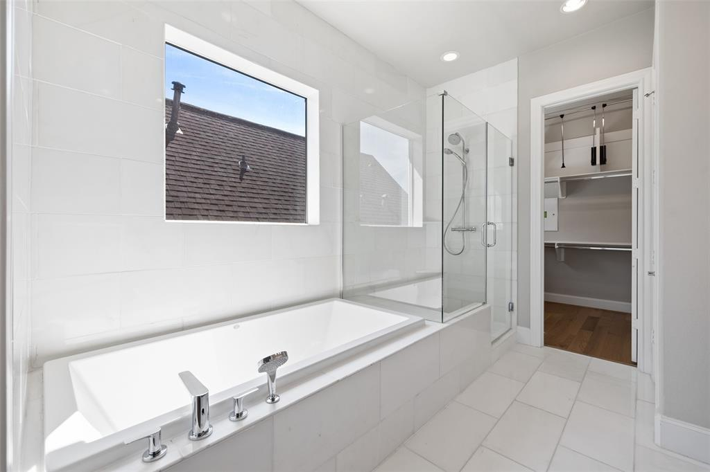 Your going to love this large soaking tub, separate standup shower, and all of the natural light that floods this space. Per the seller, the upgraded seamless shower glass provides easy clean-up and maintenance.