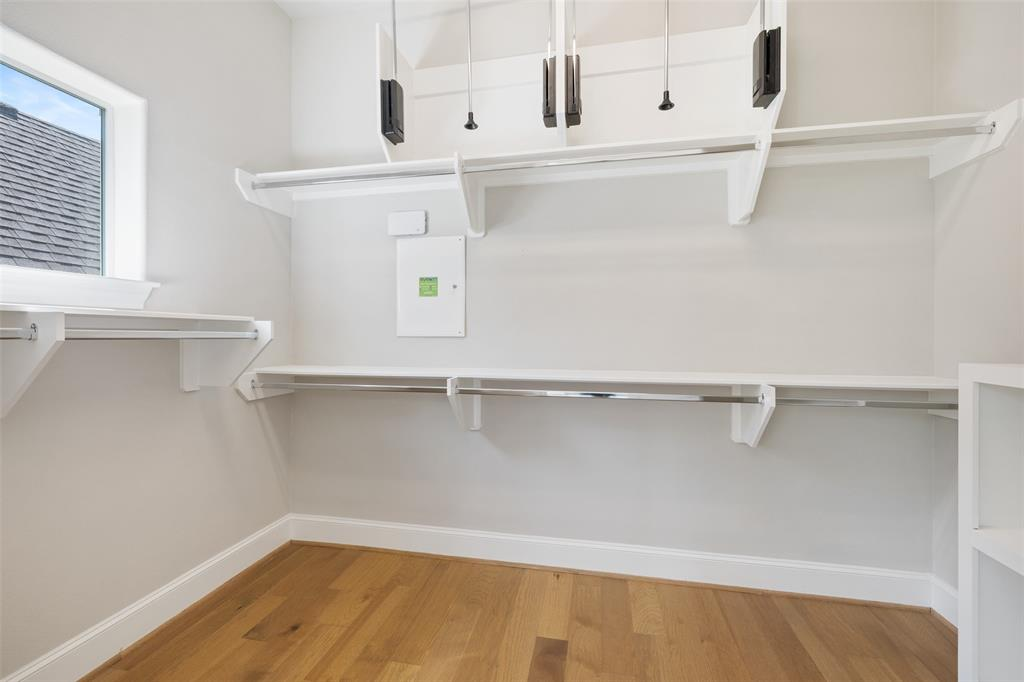 The large walk-in closet is located just off the primary bathroom. This closet and the one in the bedroom include automatic lights.