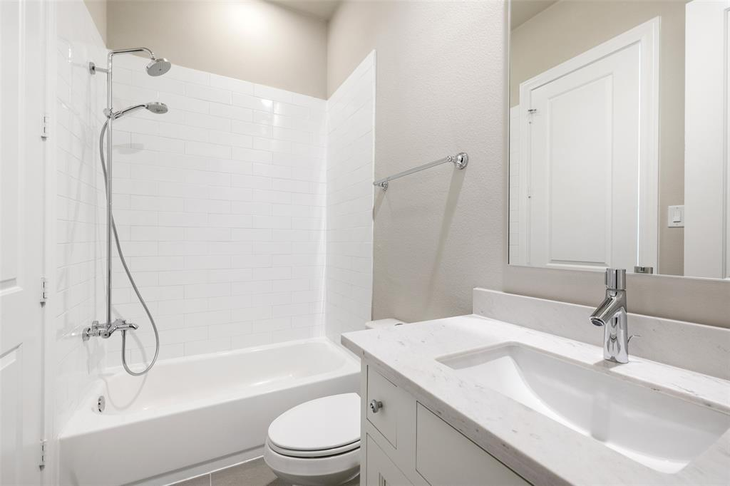 This en suite bathroom is located off the upstairs secondary bedroom.