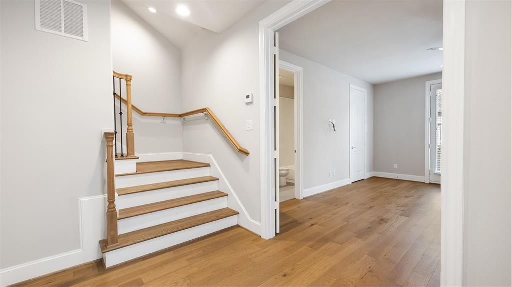 Throughout much of the home, you will find these gorgeous wood floors. There is no carpet in this home.
