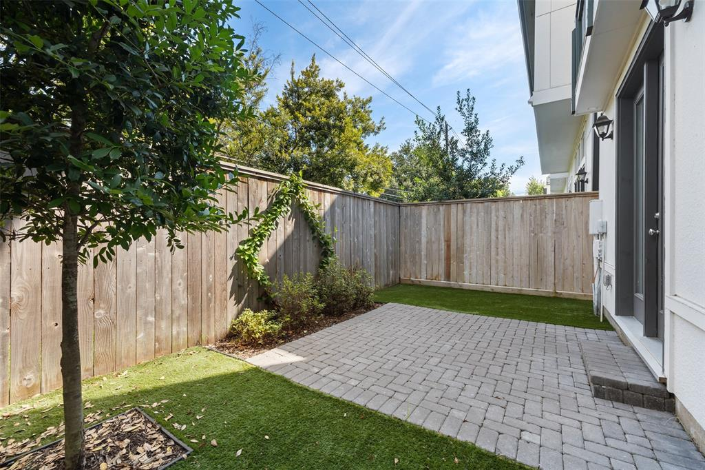 This great backyard space is perfect for your dog or kids to run around. Out back, you'll find this gorgeous paver patio and the sellers have also added low maintenance artificial turf and landscaping. You will also find a built-in gas line if you would like to add a 2nd outdoor grill.