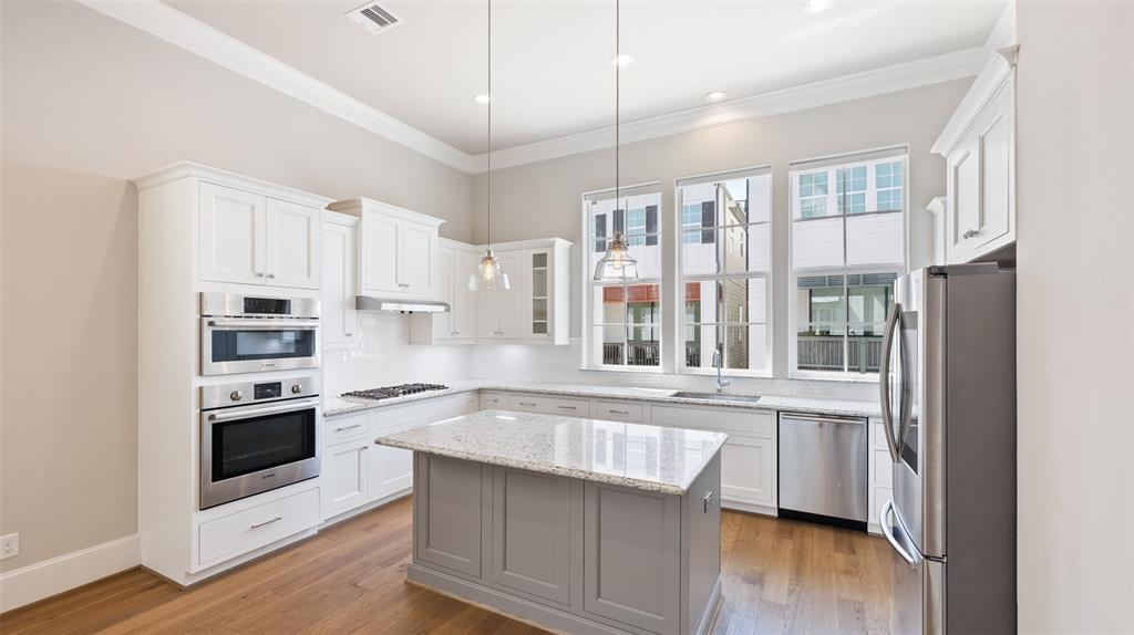 The chef in your family is going to enjoy this spacious kitchen and all of the ample storage. This island kitchen offers stainless steel Bosch appliances, double trash-bin, soft close pull-out drawers and doors, and under cabinet lighting.