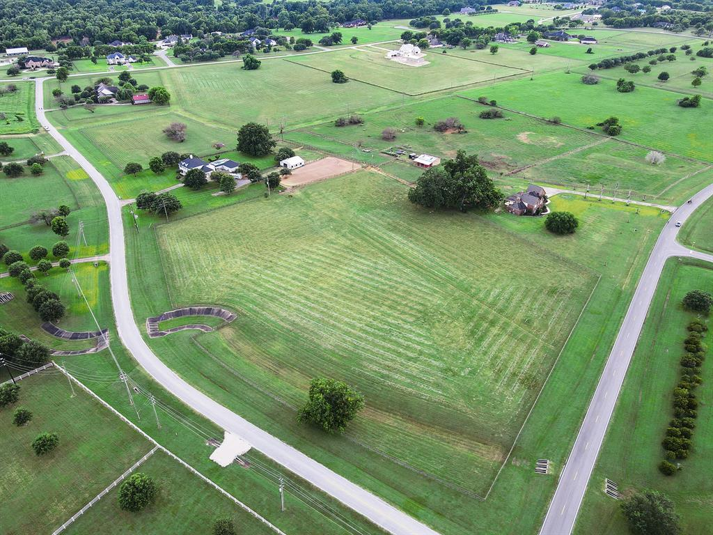 This is a lot sale only. This beautiful acreage is adjacent to also a home for sale please contact the agent for additional information and pricing of that home and acreage for sale. On this lot there is impeccable fencing all around, horse grass mostly throughout. Please contact agent for more details.