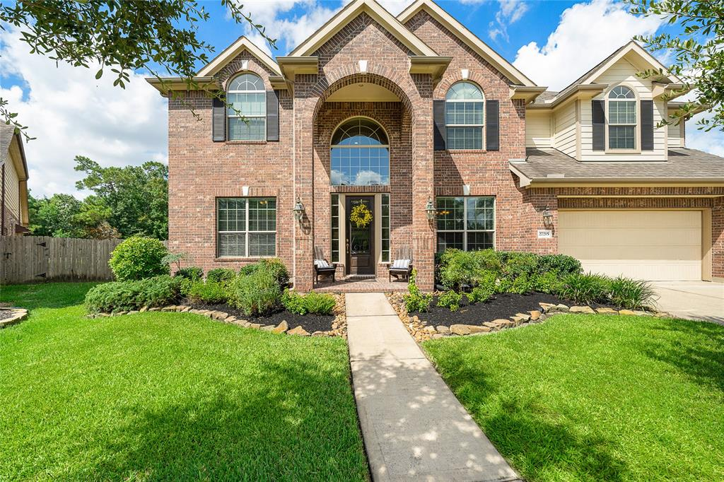 """RARE FIND!  Beautiful home situated on one of the largest lots in sought-after Spring Trails. Beautiful home offers everything you are looking for: soaring ceilings, light bright open floor plan w/breakfast area & kitchen opening to family room w/gas fireplace. Spacious kitchen is perfect for  """"home chef"""" boasting granite countertops, ample cabinets; large laundry room w/built-in shelving & washer & dryer remain; primary ensuite downstairs w/large walk-in closet w/built-in shelving, separate shower/whirlpool tub; 3 spacious secondary bedrooms up, one w/Jack N Jill bath; media/gameroom up; and  abundance storage w/floored attic space & hidden niches.  Then the backyard outdoor retreat w/amazing pool w/waterfall & spa, firepit, extended patios, pergola, and privacy backing to 4+ acres of green space & still plenty of yard left to play!  Shopping nearby, zoned for great schools & EZ access to I-45,Grand & Hardy Toll."""