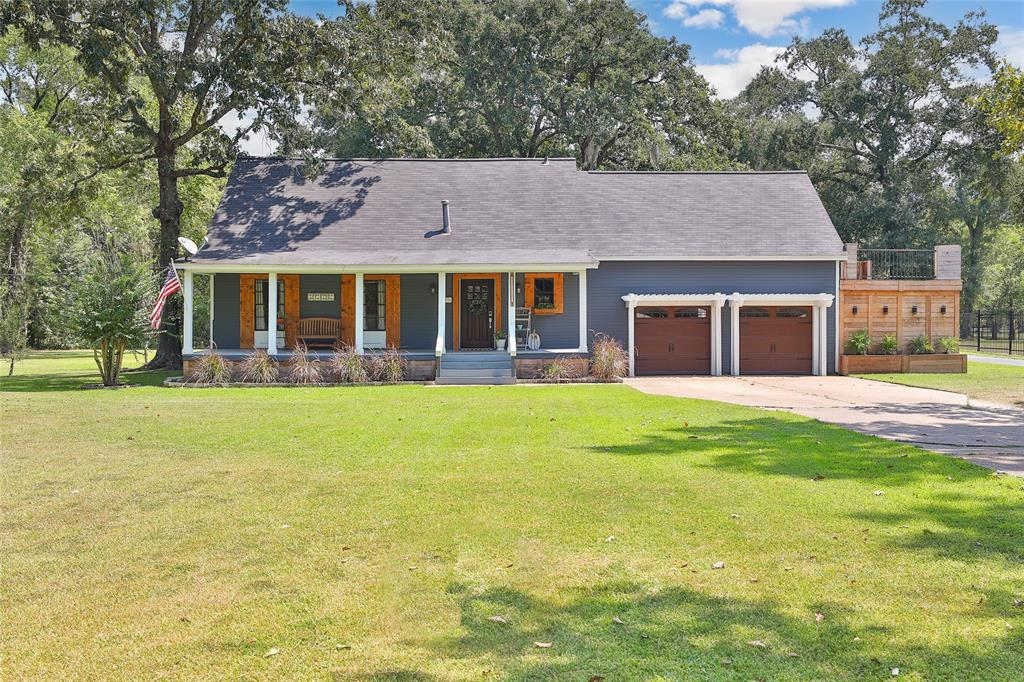 2.25 acres UNRESTRICTED land! BONUS 1665 Sq ft mobile home included! MAIN HOME 3 BED/1.5 BATH. SECOND HOME 3 BED/2BATH. Trim work around every door & baseboards make this a one of a kind home. Butcher block countertops, shaker style cabinets make the kitchen a chef's dream come true! Kitchen open to formal dining room with a large window to admire the magnificence of the property. Three large bedrooms upstairs offer plenty of windows. Extensive deck in the backyard with covered BBQ pit area is perfect for hosting all the friends and family. The beautifully maintained mobile-home provides an additional 1665 square feet (with its own driveway, septic and electric) conveys with the sale. This quaint home would be perfect for a multi-generational family or as office space for your business! Multiple storage buildings and a workshop offer plenty of space for all your hobbies! 17X60 Batting Cage.  Easy access to multiple major highways all with the quiet charm of having more room to breathe.