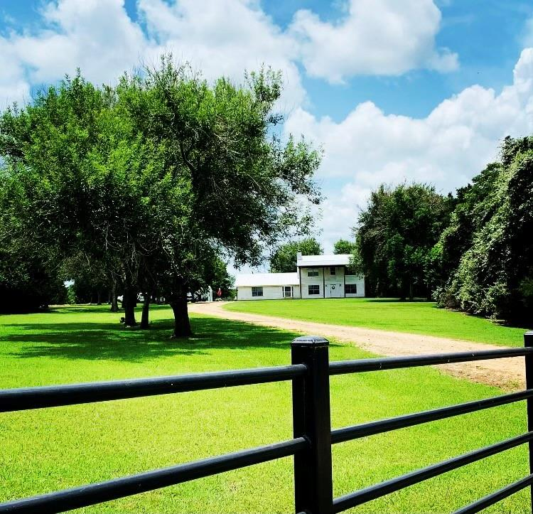 Welcome home to your own piece of beautiful New Ulm, Texas! Situated on approximately 10.69 +/-  ag-exempt acres off of FM 109 in the heart of the rolling hills. This prime ranchland has supported healthy livestock and abundant wildlife for years and now awaits new stewards. The enormous Colonial style homestead has tons of potential for a dream makeover, with an open floor plan waiting for the new owners to take over the paintbrush on this giant canvas. The property is equipped with a 20x24 out building, a 20x24 lean-to and RV hookup w/ separate power & septic. Now is the time to get out of the city and into the country way of life to enjoy the endless serenity it has to offer. Secluded country living at it's best, but less than 30 minutes to Round Top, Warrenton, Fayetteville, Bellville or Brenham for all of your unique shopping & eating desires. This peaceful country property is now available for you to enjoy all it has to offer. Call for a private tour today before it's too late!!