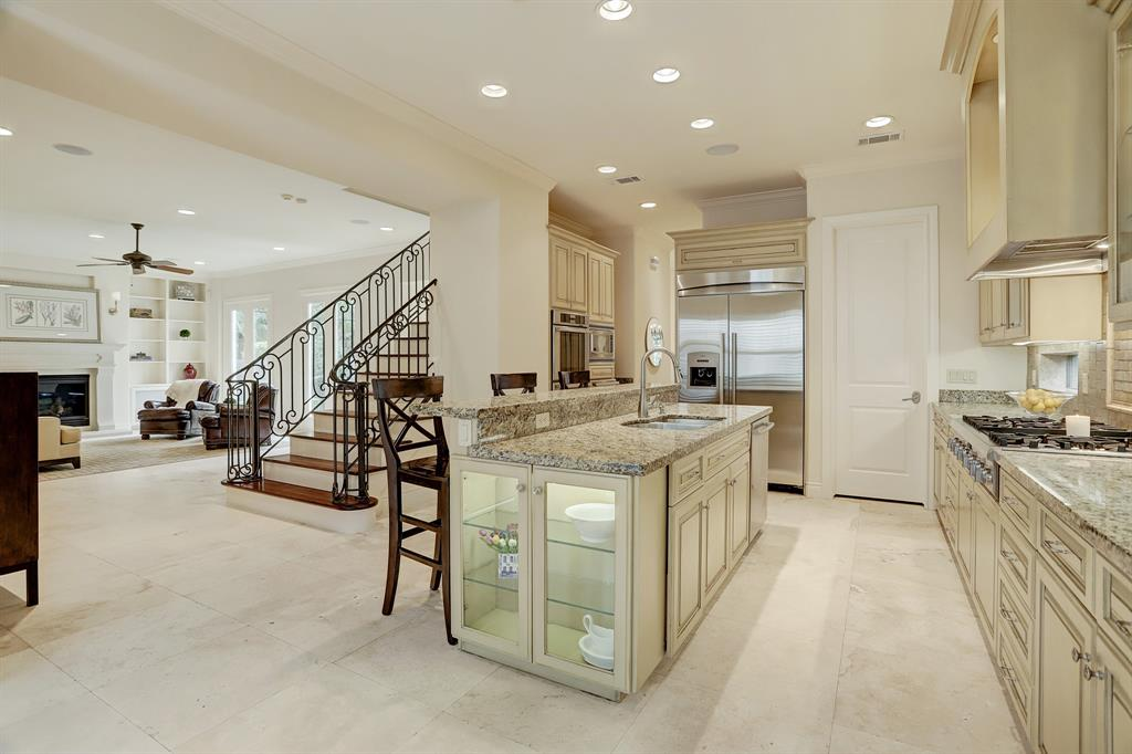 As you continue through the home you'll find the dining room overlooking the courtyard.