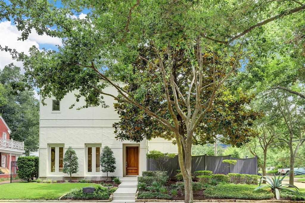 Impeccable landscaping surrounds this lovely home located on a corner lot and quiet, tree-lined street. Perfect for family bike rides and walks to favorite restaurants and shopping.