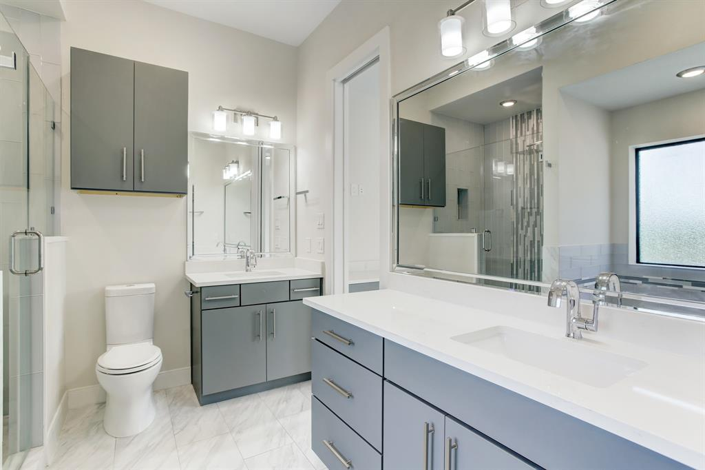 Master bathroom has double vanity with shower and tub