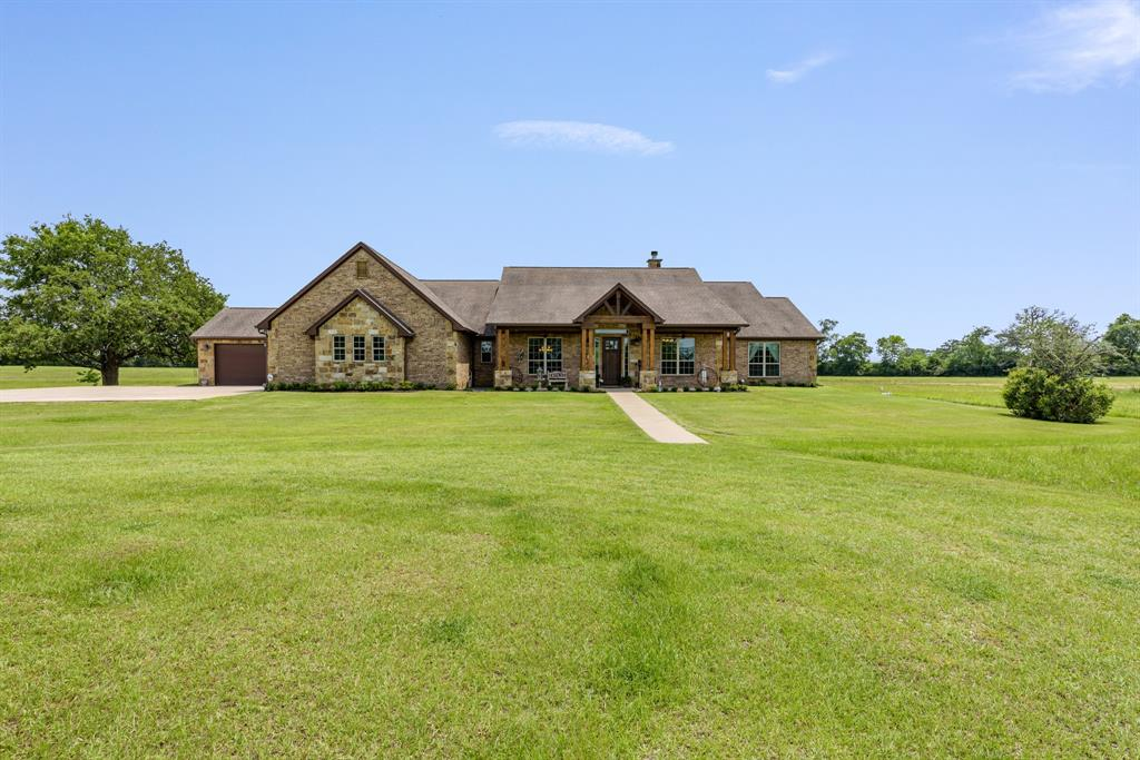 Check out this beautiful custom home located in Lovelady, Texas on 24.75-acres. An additional home on 10-acres is available next door. This home is complete with 4 bedrooms and 3.5 bathrooms. The entry way opens to a beautiful great living room with gas starter, wood burning fireplace. The kitchen is open and outfitted with beautiful cabinetry, lots of storage space and granite countertops. Off the kitchen, wonderful mud room that leads to the 4-car garage. The master bedroom is located conveniently just off the kitchen and dining room. This master bedroom is spacious with a great master bathroom complete with his and her sinks and large walk-in closet. Furthermore, off the great entertainment room, you will find a music room with insulated walls along with the 3 guest bedrooms. Two of the guest rooms share a full bath, and third guest room has its own full bath. This property also two ponds and good pastureland, as well as a water well for gardening.