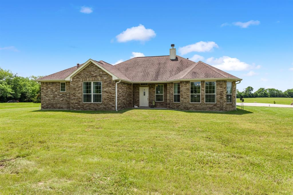 This 3/2  home is situated on 10-acres in the highly desirable Lovelady ISD with an additional home with 24.75 acres for sale next door. You're going to love this home from the moment you walk in. Walking in the entry, you will notice the high ceilings and great living room with a brick wood burning fireplace. Off the living room, you will enjoy the perfectly placed dining room and eating nook between the kitchen. The kitchen is outfitted with granite countertops, walk-in pantry, custom cabinets, and a granite island. The master bedroom is located just off the entry with a large master bathroom complete with two walk-in closets and walk-in tile shower. The two guest bedrooms share a hall bathroom that is conveniently located off the entertainment room with a walk-in tile shower. Outside the home you will enjoy the manicured 10-acres of land. The owner reports wonderful deer hunting and lots of wildlife! Give us a call today to schedule your showing of this beautiful property.