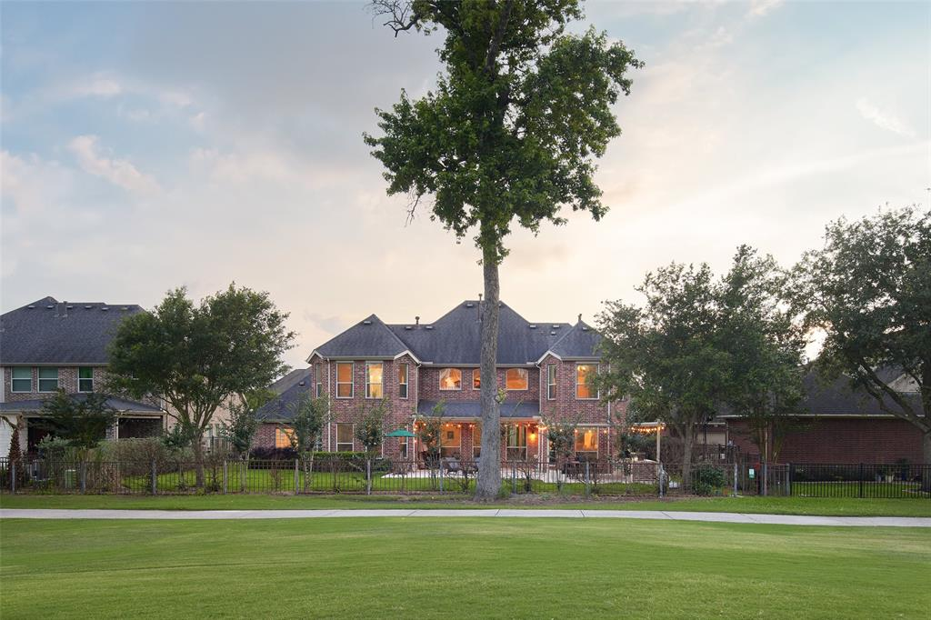 This immaculate home is on the private and prestigious Golf Club of Houston, overlooking the 15th hole. This two-story home has over $60,000 in upgrades and presents a spacious layout with abundance of natural light with soaring 20ft ceilings, 2 Master Suites, a chef's kitchen with granite countertops , large breakfast area, a private executive office or used as a 5th bedroom , game room / TV room, and a 900 square ft. outdoor living space with BBQ area for family gatherings.  Home also offers a vast backyard that you can render for your very own private pool. This private community offers two swimming pools, tennis courts, clubhouse, sports center, walking trails, a fitness center and even hosts Sundays Farmers Market. Zoned to Humble ISD and located only 15 minutes away from downtown. This one won't last long!