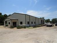 This 6.39 acre parcel is a Light Manufacturing facility of approximately 4880 +/- sq ft of shop, and is located on desirable Hwy 90 N. This Commercial property has approximately 500 ft of Hwy frontage, and is easily accessed by 18 wheelers. The facility has 5 office spaces down stairs, 2 restrooms, a parts room and a break room with a full kitchen area. Upstairs provides a large conference room, bathroom with shower and tub along with two closets and a utility room. Upstairs could easily be used as living quarters as needed.